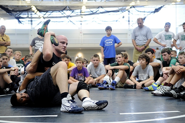 Cael Sanderson demonstrates a wrestling technique