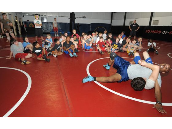 Wrestling club pairs technique with social, leadership skills
