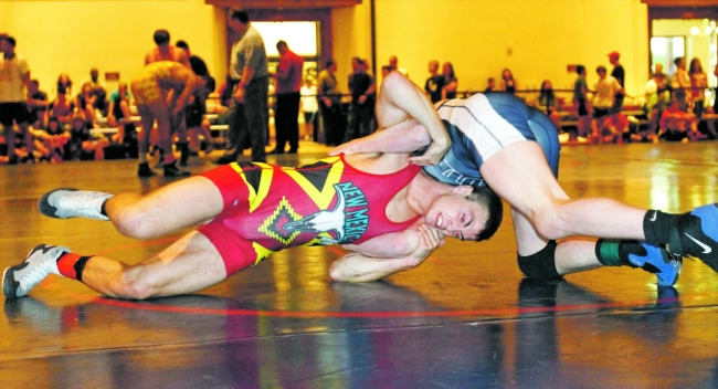 Robert Buckhanno of Las Vegas, Nev., wrestles Trevor Wilson of Arizona